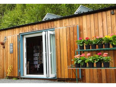 Shipping Container Conversions 40ft Siberian Larch cladded garden centre CS26667 click to zoom image