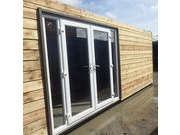 PATIO DOORS AND BI-FOLDING DOORS IN SHIPPING CONTAINERS